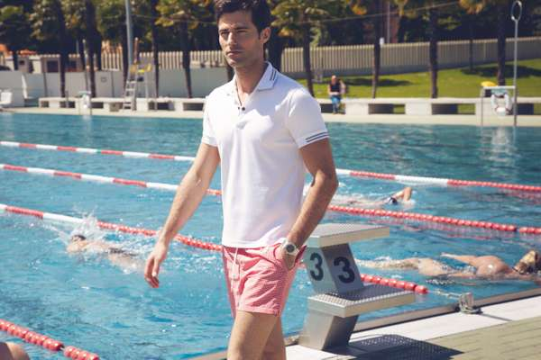Polo shirt by Zegna Sport, swim trunks by Canali, watch by Audemars Piguet