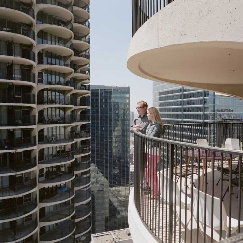 Andrew and Melissa Moddrell on the balcony of their East Tower unit