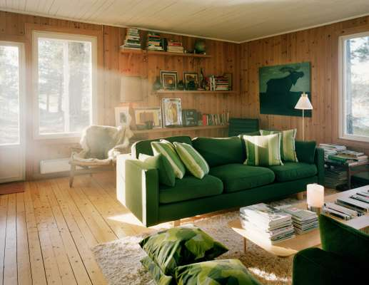 The wooden interior is softened with a shaggy rug and plenty of cushions