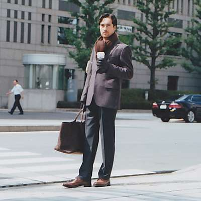 Jacket by Boss Black, trousers by Louis Vuitton, scarf, gloves, bag by Bottega Veneta, shoes by Max Verre
