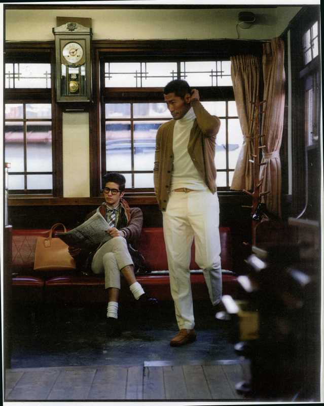 Alex (LEFT) wears glasses by Moscot, jacket by Mcritchie for Tomorrowland, shirt by Errico Formicola for Tomorrowland, scarf by Roda for Tomorrowland, tie by Seaward & Stearn for Tomorrowland, trousers by Visvim, shoes by Nepenthes, bag by Porter. Yusuke (RIGHT) wears cardigan by Prada, jumper by Hermès, trousers by Dior Homme, belt by Andrea Greco for Tomorrowland, shoes by Tod's