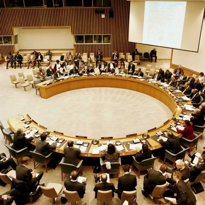 Security council session, with Nishida seated top centre