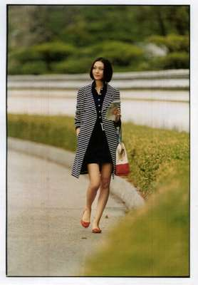 Coat by Christian Dior, dress, bag and shoes by Fendi, earrings and bracelet by Duna