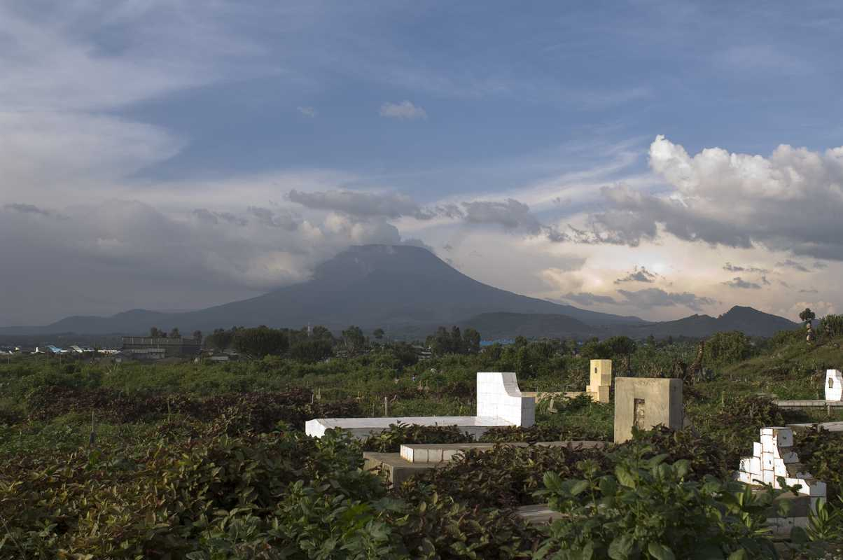 Goma volcano with graveyard in foreground