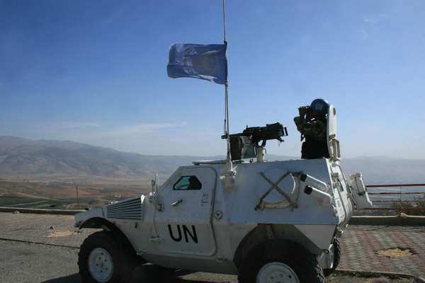 Peacekeeper of the UN Interim Force in southern Lebanon monitors Israel border