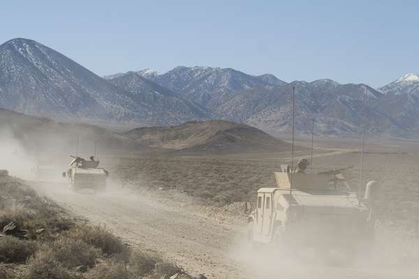 Marine convoy heads towards the mock village in the Nevada mountains