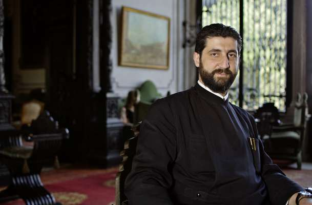 Greek Orthodox priest in the Palais Sursock