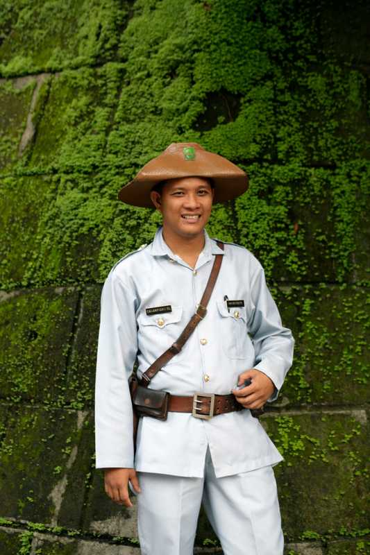 A guard outside Intramuros, Manila's historic walled district