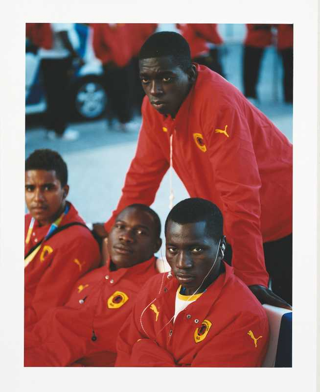 Angolan football players watch the opening ceremony celebrations