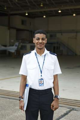 Twenty-year-old Tawfiq Jeneby on the tarmac outside the hangar