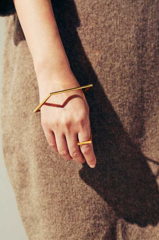 Dress by Sofie D'Hoore,  bracelet and ring by Minimalux