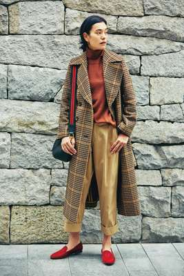 Coat and bag by J&M Davidson, rollneck jumper by Orazio Luciano, trousers by Scotch & Soda,  shoes by Giorgio Armani, earrings by Astley Clarke, ring by Repossi,