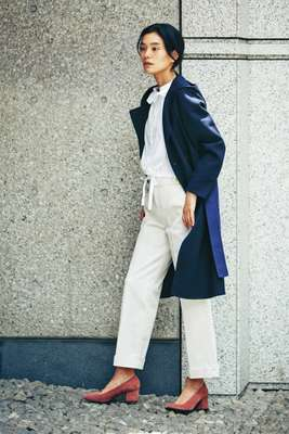 Coat by Sealup, shirt by Atlantique Ascoli, trousers by Scotch & Soda, shoes by Aeyde, earrings by Sarah & Sebastian