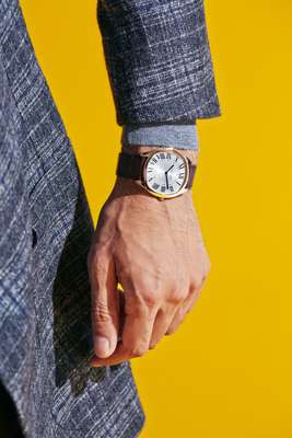 Jacket by Pal Zileri, jumper by Tagliatore, watch by Cartier