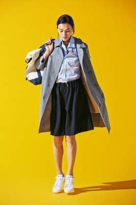 Coat by Mackintosh, shirt by Orazio Luciano, shorts by Sofie D'Hoore, trainers by Adidas, bag by Sacai