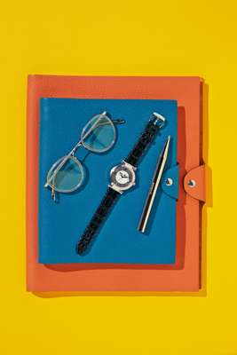 Notebook covers by Hermès, glasses by Oliver Peoples, watch by Chopard, pen  by Minimalux