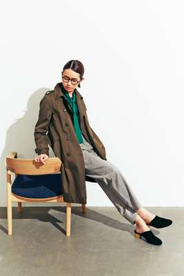 Coat by Sealup, shirt by Golden Goose Deluxe Brand, trousers by De Bonne Facture, shoes by Salvatore Ferragamo, glasses by Cutler and Gross chair by Maruni