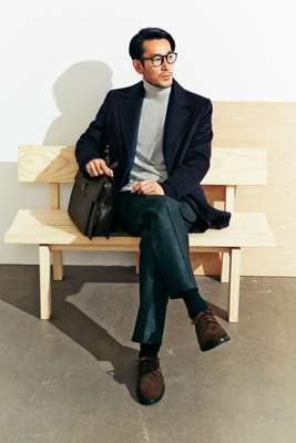 Coat by Paul & Shark, suit by Pal Zileri rollneck jumper by  Orazio Luciano, socks by Beams, shoes by APC, glasses by Ray-Ban, bag by Bottega Veneta, bench by Maruni