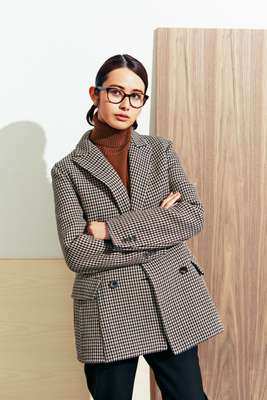 Jacket by Santoni Edited by Marco Zanini, rollneck jumper by Altea, trousers by Arket, glasses  by Prada