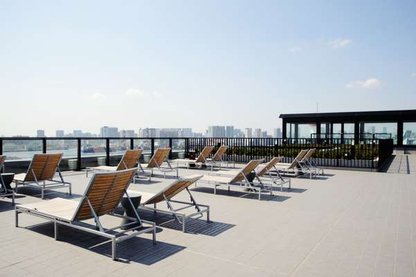 Sun loungers on the roof of the Soho