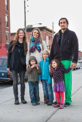 A Red Hook family outside a playground