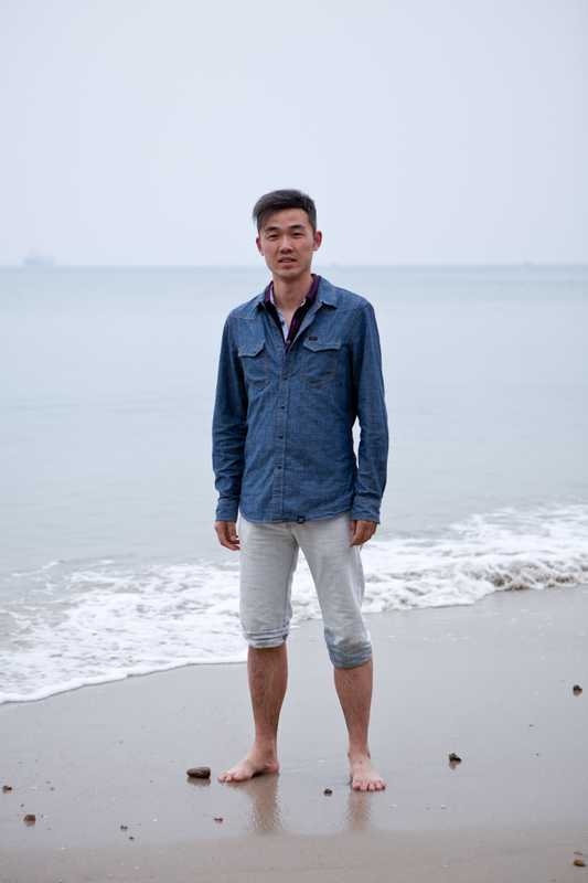 Tony Zhao on the beach in Sanya, visiting from Shanghai
