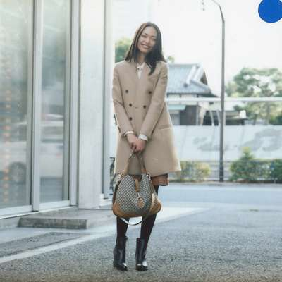 Coat by Gucci, shirt by Martinique Marunouchi, skirt by Drawer, shoes by Black Fleece by Brooks Brothers, bag by Gucci