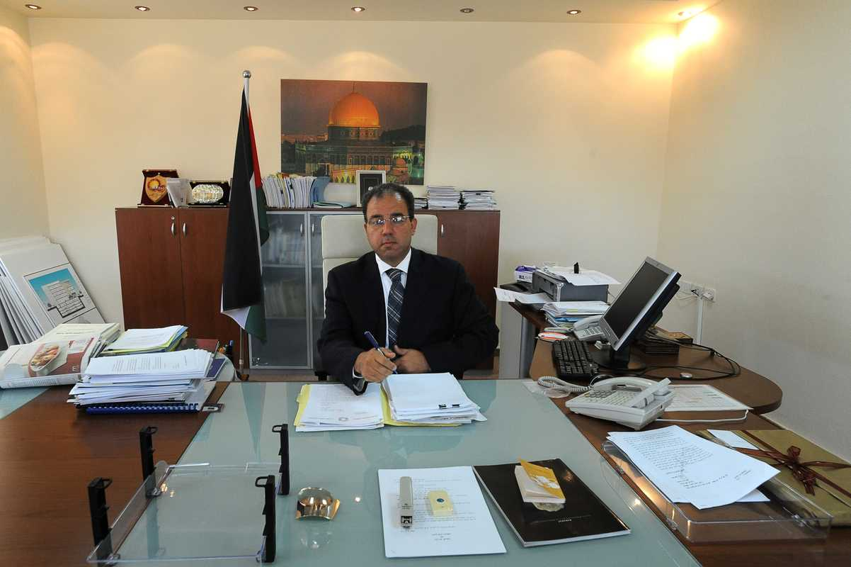 Al-Wazir in his office