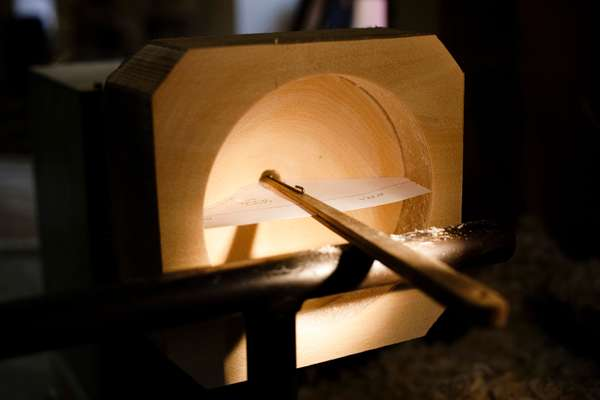 Wooden moulds are made to the exact measurements of the intended shape of the glass pieces