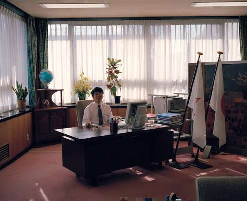 Taue in his office