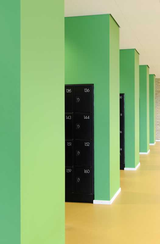 A bright splash of green for the lockers is some of the only colour in an otherwise muted and natural scheme