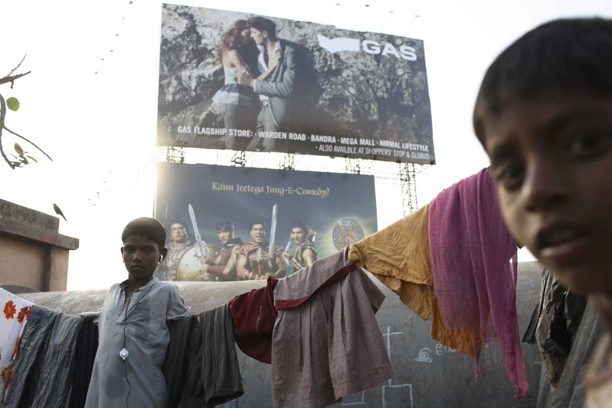 Brand ads make a poignant backdrop to the slums