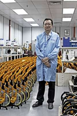 David Lim, manager of a factory that makes distance-measuring instruments for British firm Trumeter