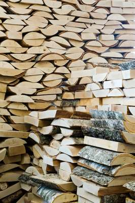 Logs piled ready for making into soles