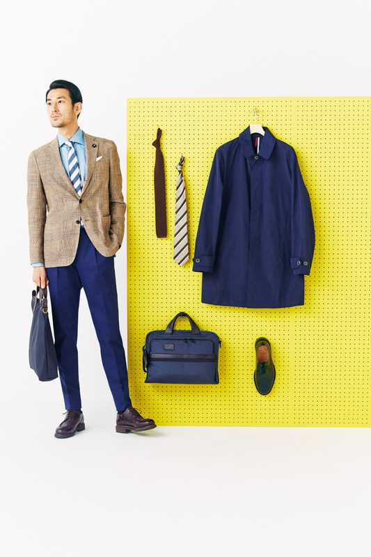 He wears: jacket by Lardini from Ships, shirt by Orazio Luciano, trousers by GTA, socks by Tabio, shoes by Paraboot, tie by Sergej Laurentius, pocket square by Drake's, bag by Mismo. on the board: tie (left) by United Arrows, tie (right) by Franco Bassi from Beams, coat by Brooksfield, bag by Tumi x Sophnet, shoes by Church's