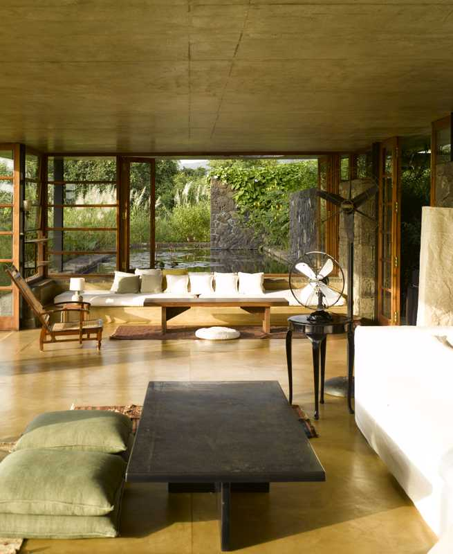 Living space opens onto the pool and the landscape beyond