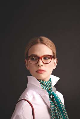 Glasses by Oliver Peoples, scarf and bag by Delvaux, shirt by Trussardi