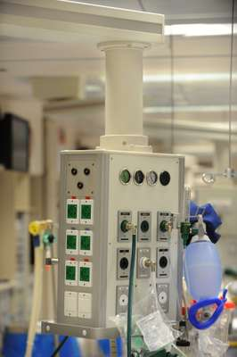 A console for medical equipment is above each bed