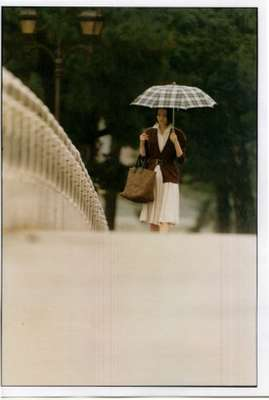 Dress by Salvatore Ferragamo, cardigan by Fendi, bag by Bottega Veneta, umbrella by Traditional Weatherwear