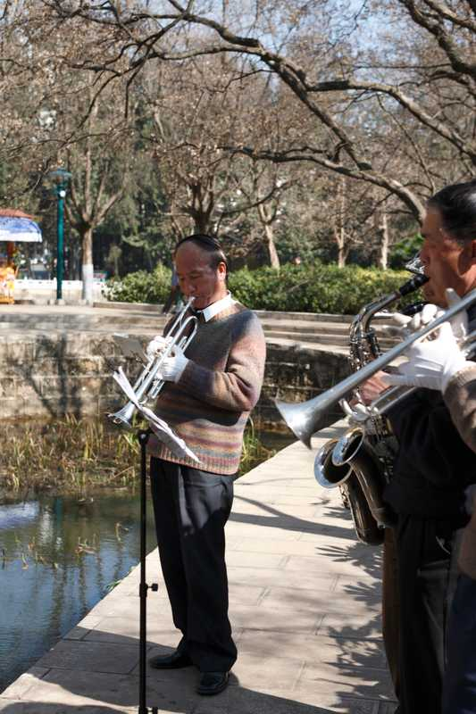 A group of musicians practise at the Green Lake