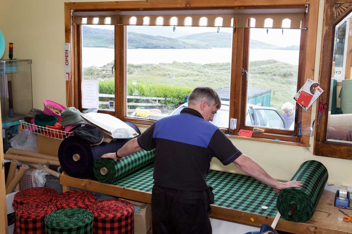 Don Mackay works at home, looking over the beach at Luskentyre
