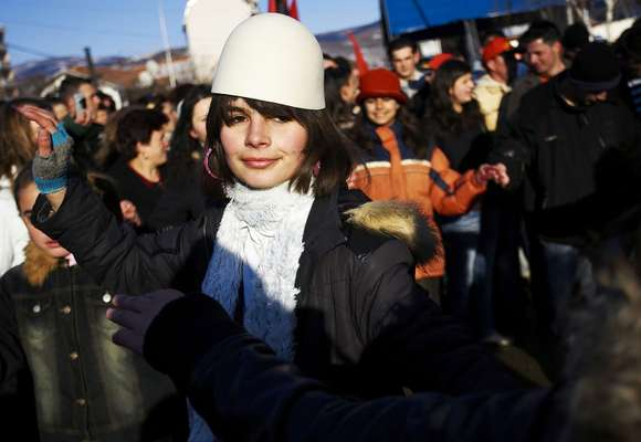 A Kosovo Albanian, wearing the traditional Albanian hat, celebrates in Mitrovica