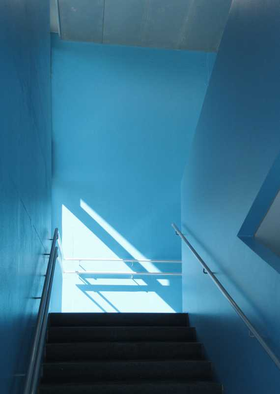 Colour is used in the stairwells to mark floors