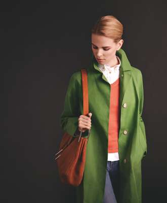Coat by Mackintosh, v-neck jumper by Zanone, shirt and jeans by Maison Kitsuné, bag by Delvaux