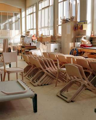 Unfinished Lyra chairs awaiting assembly