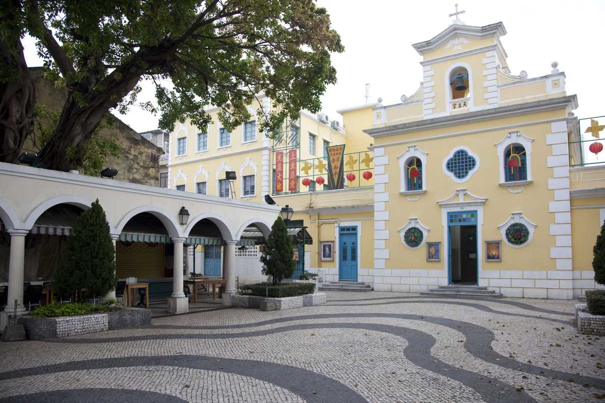 A colonial square with traditional Calçada à Portuguesa paving