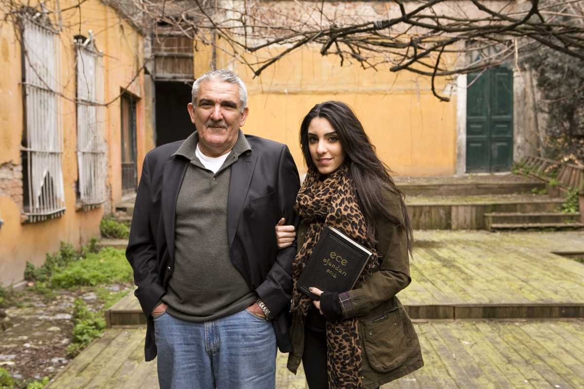 Murat Gunsiray and his daughter Sedef in front of the derelict Ece workshop in old Istanbul