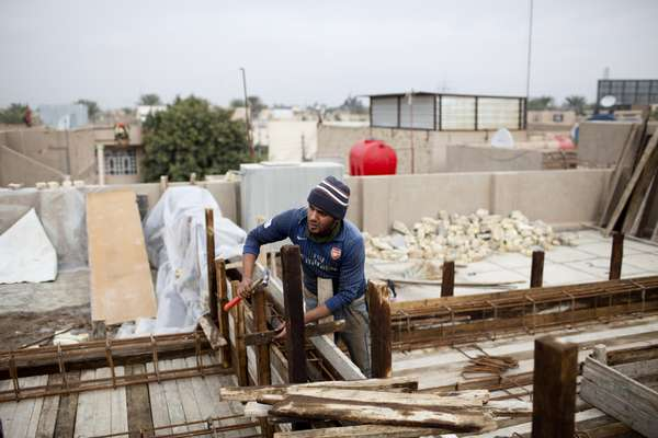 Assan Alawi helps build new houses in the Amil district of Baghdad
