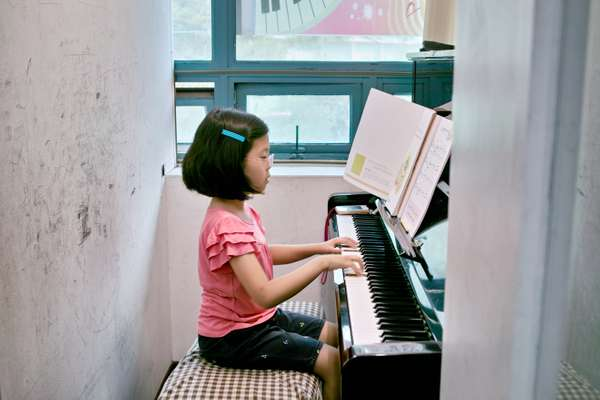 Cho Yun-je, eight, plays the piano