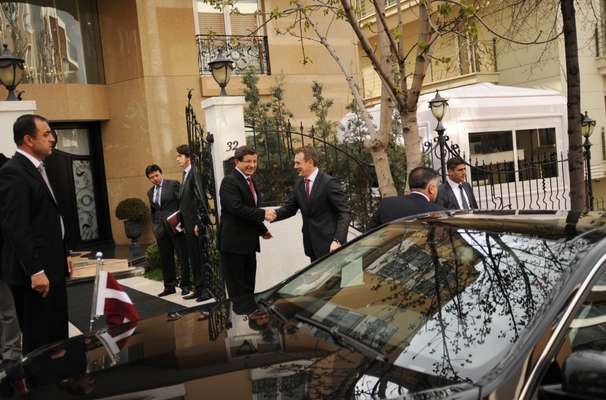 Davutoglu greets the Latvian minister of foreign affairs